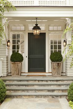 Front porch with beautiful lighting and plants