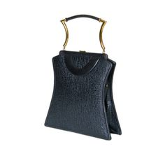 Shapely Textured Leather Handbag by Holiday | From a collection of rare vintage handbags and purses at http://www.1stdibs.com/fashion/accessories/handbags-purses/