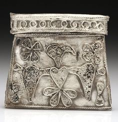 Amulet container in silver with an image of an eagle. A Viking burial ground dated to the late 10th and early 11th centuries has been discovered in Poland connected to the presence of migrants, mostly from Scandinavia.