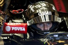 Lotus F1 Team's French driver Romain Grosjean sits in his car during the fourth day of the Formula One pre-season tests at Jerez racetrack in Jerez on February 4, 2015.