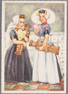 Twee meisjes in Zeeuwse streekdracht, met speculaaspop en suikerhart.