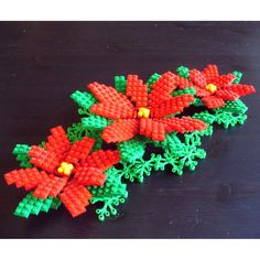 This unique custom poinsettia made from LEGO ® elements is just the thing to liven up your home for Christmas. Great as a table decoration or cake topper. This set comes with 1 large poinsettia flower x 8 Lego Christmas Tree, Christmas Home, Christmas Wreaths, Christmas Gifts, Christmas Decorations, Lego Minecraft, Lego Disney, Lego Hacks, Lego Decorations
