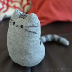 If you're a fan of Pusheen, or simply like cats, this tutorial will teach you how to make once from a sock! #Sockdolls
