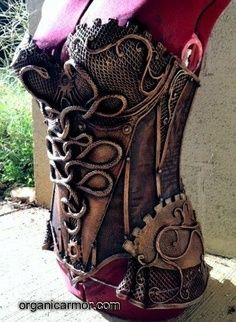 The Medusa corset. Notice the coiling snakes and steampunk gears. - Spotlight on Organic Armor