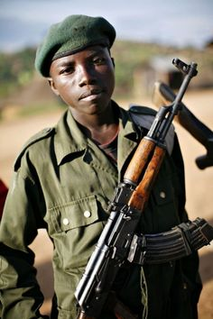 Child soldier stands at the front line in eastern Congo. chose to adopt a boy first because I know that he'd be sent to war young, and taught to rape and kill.