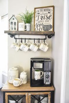 coffee bar ideas Farmhouse Coffee Bar with DIY floating shelf and mug rack The Frugal Homemaker Coffee Bars In Kitchen, Coffee Bar Home, Home Coffee Stations, Coffee Shop, Coffee Kitchen Decor, Cozy Coffee, Kitchen Small, Coffee Lovers, Country Kitchen