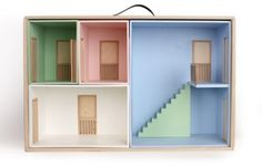 portable doll house. great to make yourself from boxes & colored paper.