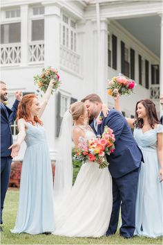 groom kisses bride with bridal party cheering next to them   Spring wedding in Berryville VA at Rosemont Manor with bright florals photographed by destination wedding photographer Idalia Photography. #RosemontManor #IdaliaPhotography #SpringWedding #BrightWeddingFlowers