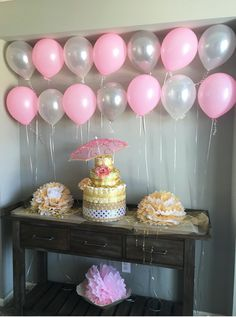 Diaper cake. Baby shower. Pink, gold and gray. Balloon wall. Tissue poms. Baby shower decor.