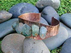 Erosion Gemstone Cuff Instructor: Kat Clark Workshop Fee: $35 Saturday, January 16 (1-4pm) Gemstones and metal sheet create a look of wear in Erosion Cuff. Water eddies underneath the cuff pull at the surrounding stones with a cold-connection technique called couching. Students will form, texture, and connect two of earth's elements in this cool cuff. Sheet metal experience is required. Materials list.