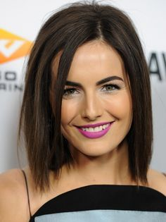 Camilla Belle's choppy cut and electric orchid smile.