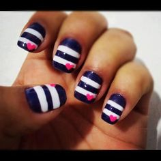 blue and white striped nails with a pink heart