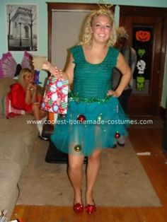 Homemade Christmas Tree Costume: I wore a homemade Christmas tree costume. I bought a tutu on and sewed on ornaments throughout the skirt. I then strung battery operated lighters that