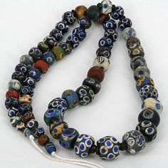 A strand of ancient Mosaic Glass Eye Beads from the Islamic world and beyond.  | Material Mosaic glass.