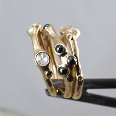 Johnny Ninos, Barnacle Rings (14 kt gold, black and clear rose-cut diamonds)