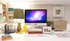 """""""I opted to store most of my supplies in my desk drawers and only keep the essentials out in the open—it leaves more room for fun accessories. I know it's easy to go overboard with personal touches, but I like that I have pretty and decidedly non-office-y things to look at while I'm working. To me, it feels cozy, not corporate."""" Diary scheduler, $20.95; Mochi Things."""