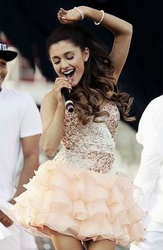 Ariana Grande. She's a beauty! She is a very good role model to just about everyone! People say she sounds like Mariah Carey but I think she is unique with her voice. I Ariana Grande