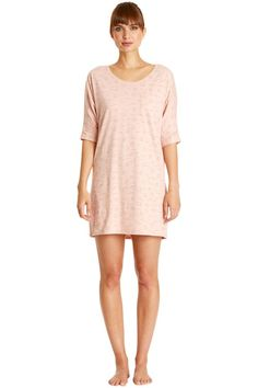 Pale pink nightdress with cloud print in 100% organic certified cotton jersey. Front pocket. Length 88cm.