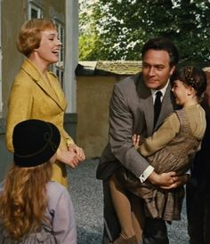Maria and the Captain greeting Marta and Gretl after getting back from their month-long honeymoon.
