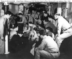 USS Wichita (CA-45)  Ship's Chief Petty Officers listen to the radio broadcast of President Franklin D. Roosevelt's address to the Congress requesting a declaration of War against the Axis powers, circa 8 December 1941.  Note phograph of President Roosevelt on the bulkhead.