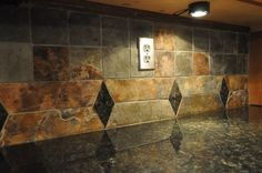 Uba Tuba granite countertop tile backsplash earthy colors kitchen lighting