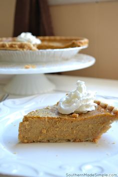 Pumpkin Custard Pie - a delicious twist on everyone's favorite Fall recipe: Pumpkin Pie! This particular pie has a very creamy texture and is perfect with a tall glass of milk!