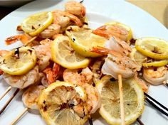 Marinate shrimp in olive oil & garlic, place shrimp on skewers and put on the grill with lemons 3 minutes on each side.