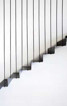 "Suspended Black Steel Lower Internal Stair Detail ""Like the black steel look on poles but do not really think that the black steel stairs would fit with look of house. Would prefer to have closed in under the stairs"""