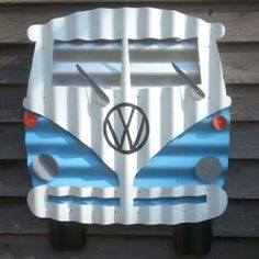 This blue Kombi is constructed from recycled corrugated iron.    Painted with high quality Dulux outdoor paints for longevity and bright colours.    * Great gift idea  * Doesn't blow smoke  * Cheap to rego and insure  * Great on fuel    Can be made to custom colours – contact us for details.