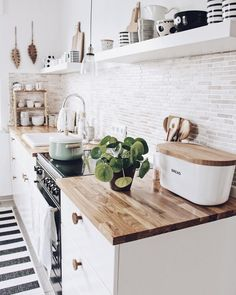 Beautiful calm and rustic kitchen. Love all the wood and stunning monochrome dec… Beautiful calm and rustic kitchen. Love all the wood and stunning monochrome decor Modern Farmhouse Kitchens, Farmhouse Kitchen Decor, Kitchen Interior, Home Kitchens, Kitchen On A Budget, New Kitchen, Kitchen Dining, Kitchen Ideas, Boho Kitchen