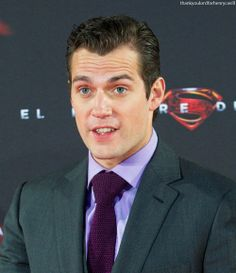 Henry Cavill's cute facial expressions at MOS Madrid premiere 2013