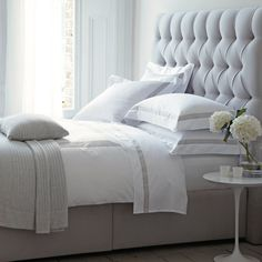 Gorgeous bed linen by The White Company. Love the fresh flowers by the bed.