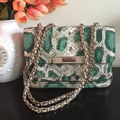 Guess green snake handbag Can be worn as shoulder or crossbody bag if you pull the chain tight. Double compartment interior with extra pocket on the outside. In perfect condition.  Material is shiny Guess Bags