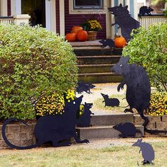 Turn a simple craft into an eerie lawn display by enlarging these cutouts and transferring to plywood: http://www.bhg.com/halloween/outdoor-decorations/halloween-outdoor-makeover/?socsrc=bhgpin092714ratsilhouettes&page=7