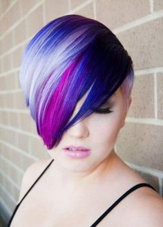 Colored hair! Pink, purple and blue with a great cut too.