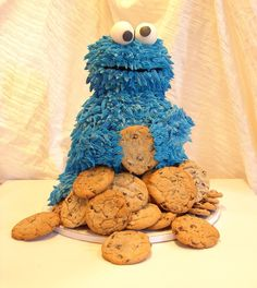 """Cookie Monster - Made this for my son's first birthday... He's all cake. Special thanks to AmyCakes2 for her informative picture of her Cookie cake. 10"""" round, 2-8"""" rounds, wondermold, ball pan... I totally cheated and used store bought cookie dough for the cc cookies- TFL!"""