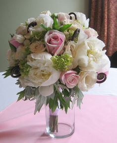 Bridal bouquet in pinks and ivory with peonies, roses, spray roses,hydrangea, mint, fern curls
