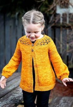 Pretty handknit little girls sweater in a lovely autumn color!
