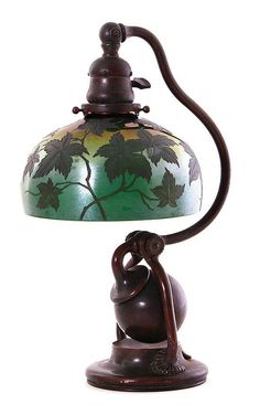 Tiffany Studio bronze counter-balance desk lamp circa 1895-1905, foliate etched green-cased glass shade; base stamped: Tiffany Studio, New York, 416; and shade marked: L.C. Tiffany Favrile.  Provenance: Charleston, South Carolina private collection.