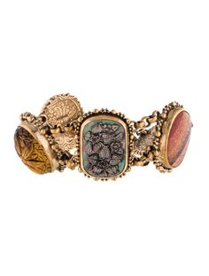 $297.00  Brass sterling silver textured Stephen Dweck link bracelet with bezel set quartz backed by metallic foil, yellow moss agate cabochon, red chalcedony cabochon, and carved tiger's eye quartz embellishments and toggle clasp closure.