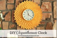 The secret of this fun, inexpensive clock? Its border is made from lots  lots of colorful plastic spoons.