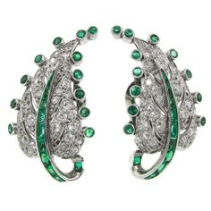 Art Deco Emerald Diamond Platinum Leaf Earrings  | From a unique collection of vintage more earrings at https://www.1stdibs.com/jewelry/earrings/more-earrings/
