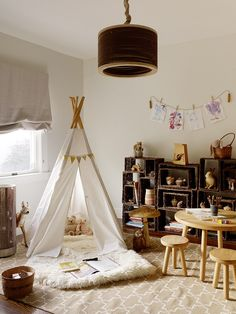 In this toddler's bedroom, willow baskets create a rustic display as well as an accessible toy storage system | archdigest.com