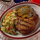 Maple-Pepper Chops with Sizzling Applesauce - Grilling goes beyond the summer season and not just in the fair weather regions. Add sizzle to your winter menu with this pork chop recipe. Grilling time may need to be extended depending on how low the mercury drops. Round out the meal with grilled squash and a fresh winter slaw. Keep the chef warm by using the remaining apple juice for a hot apple drink.
