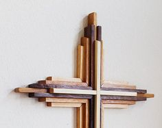 Four-Foot-High Layered Cross  This handmade, layered cross makes a great centerpiece in your home or place of worship. Ive scaled this popular design to be four feet tall by 26 inches wide.  This is a Made-to-Order Item Please allow up to four weeks for production and delivery time. I'll contact you after the sale to give you a production and delivery timeline.  Materials Made from three separate types of solid wood. I can use any combination of domestic woods you prefer. Popular wood…
