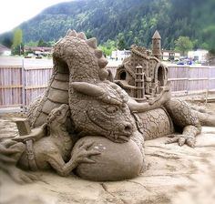 Dragon and castle sand sculpture - I love how intricate some people can get with sand sculptures!