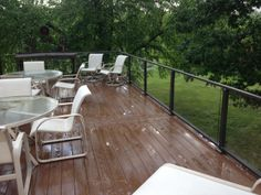Timber Tech Terrains composite deck in brown oak with Westbury aluminum railing with glass in fill.