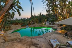 Twilight star Robert Pattinson enjoys a lagoon-like swimming hole in the backyard of his $6.75 million dollar padinLos Angeles.