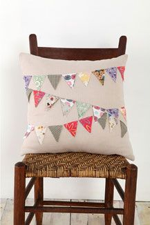 bunting pillow- good idea for fabric scraps.