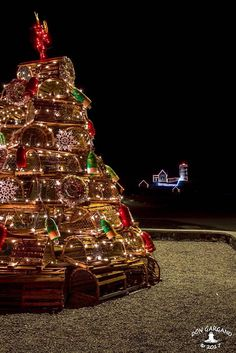 Lobster Trap Christmas Tree Lobster Trap Christmas Tree, with Nubble Lighthouse in the background.  Sohier Park, York, Maine. Prints available at https://dongarganophotography.smugmug.com/Photos-For-Sale Photo by Don Gargano Photography